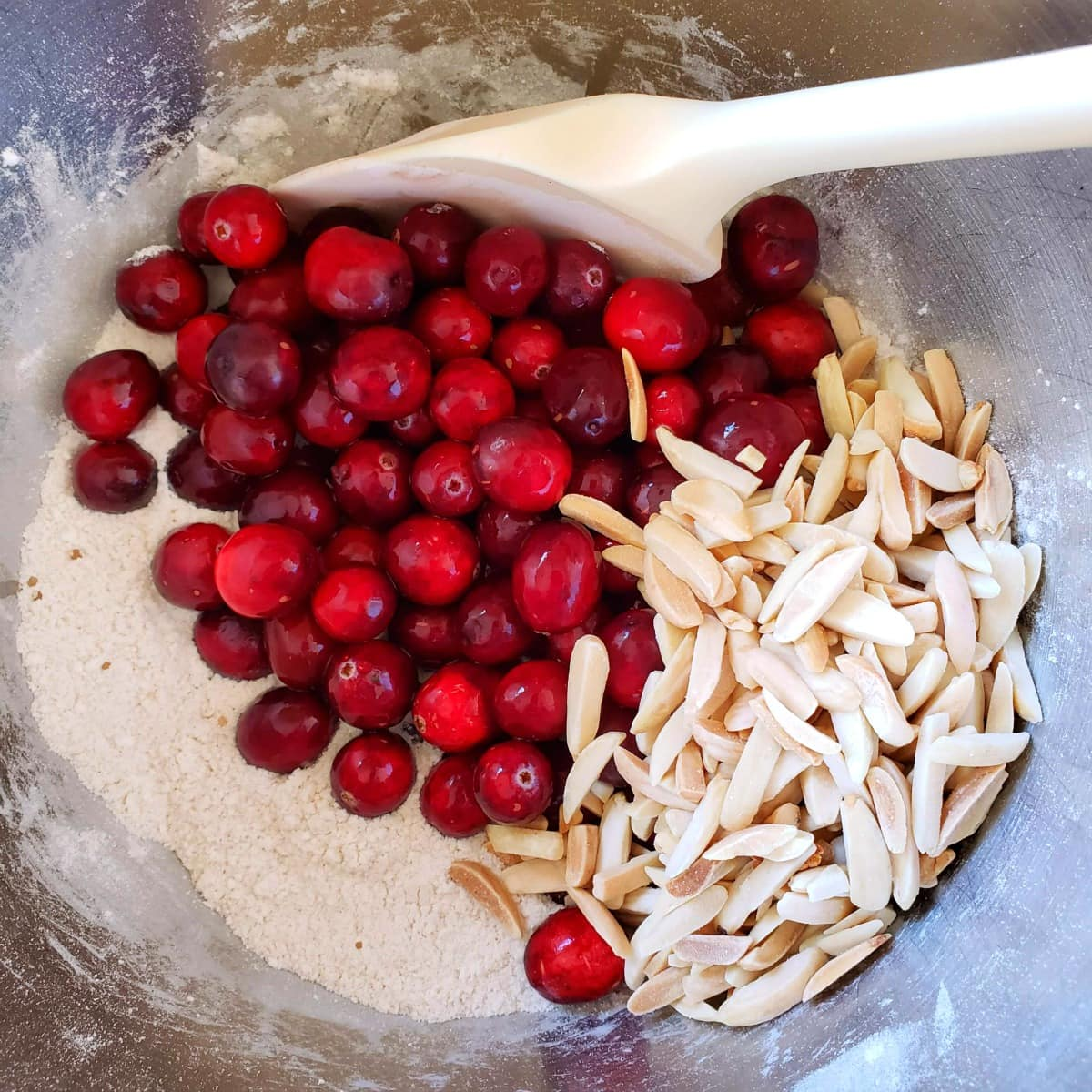 Cranberries and almonds go into the cake