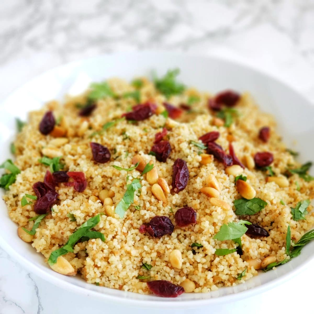 Cranberries on top of couscous
