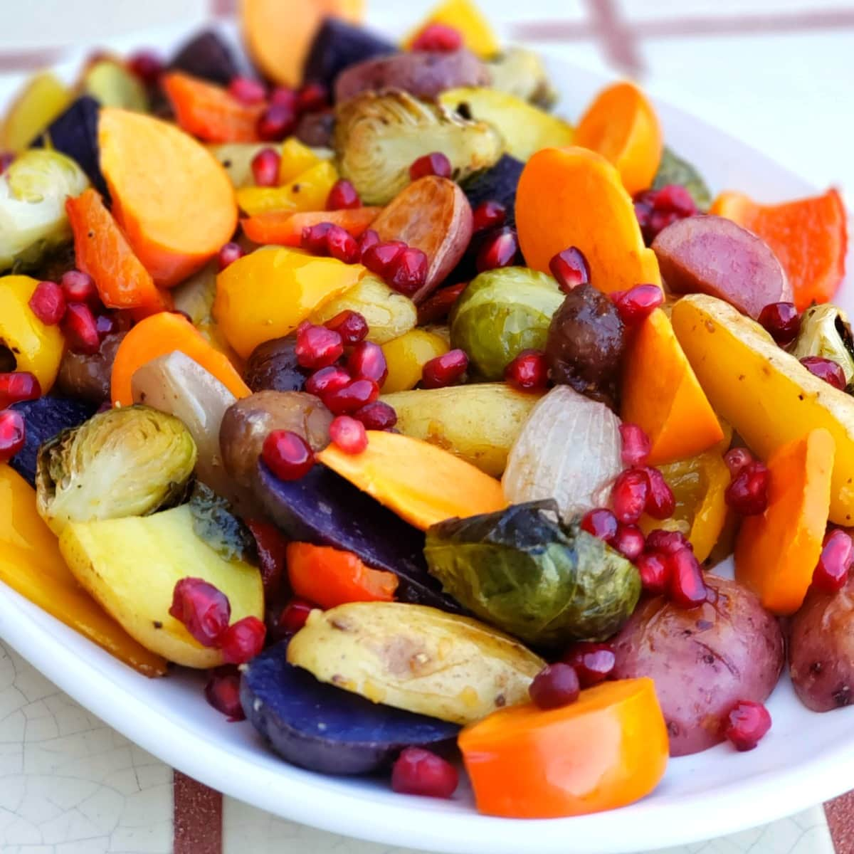 Roasted Rainbow Vegetables take the simplest, most delicious, seasonal vegetables and roast them quickly to perfection, for a colorful, healthy side dish or vegan main dish.