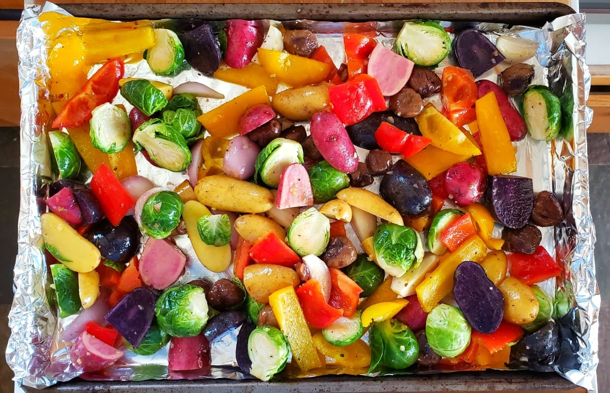 Vegetables go onto a foil-lined baking sheet