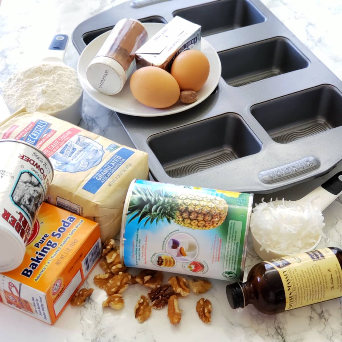 Ingredients for Pineapple Coconut Quick Bread on a white marble counter