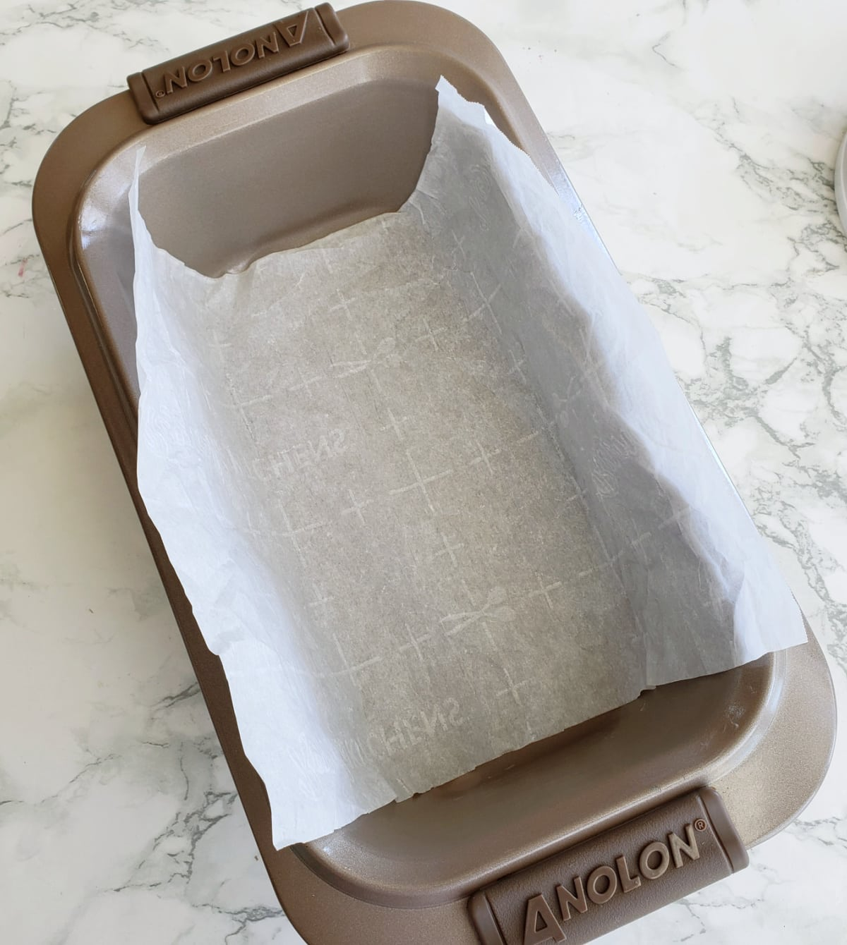 Line the loaf pan with parchment paper