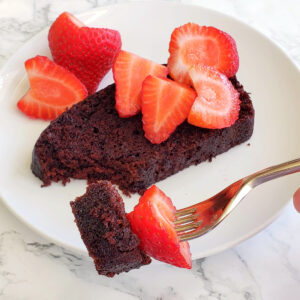 Vegan Chocolate Loaf Cake with berries on top on ShockinglyDelicious.com