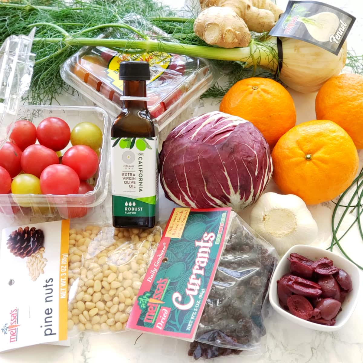 Ingredients for Pasta with Fresh Tomatoes and Tangerines on a marble counter