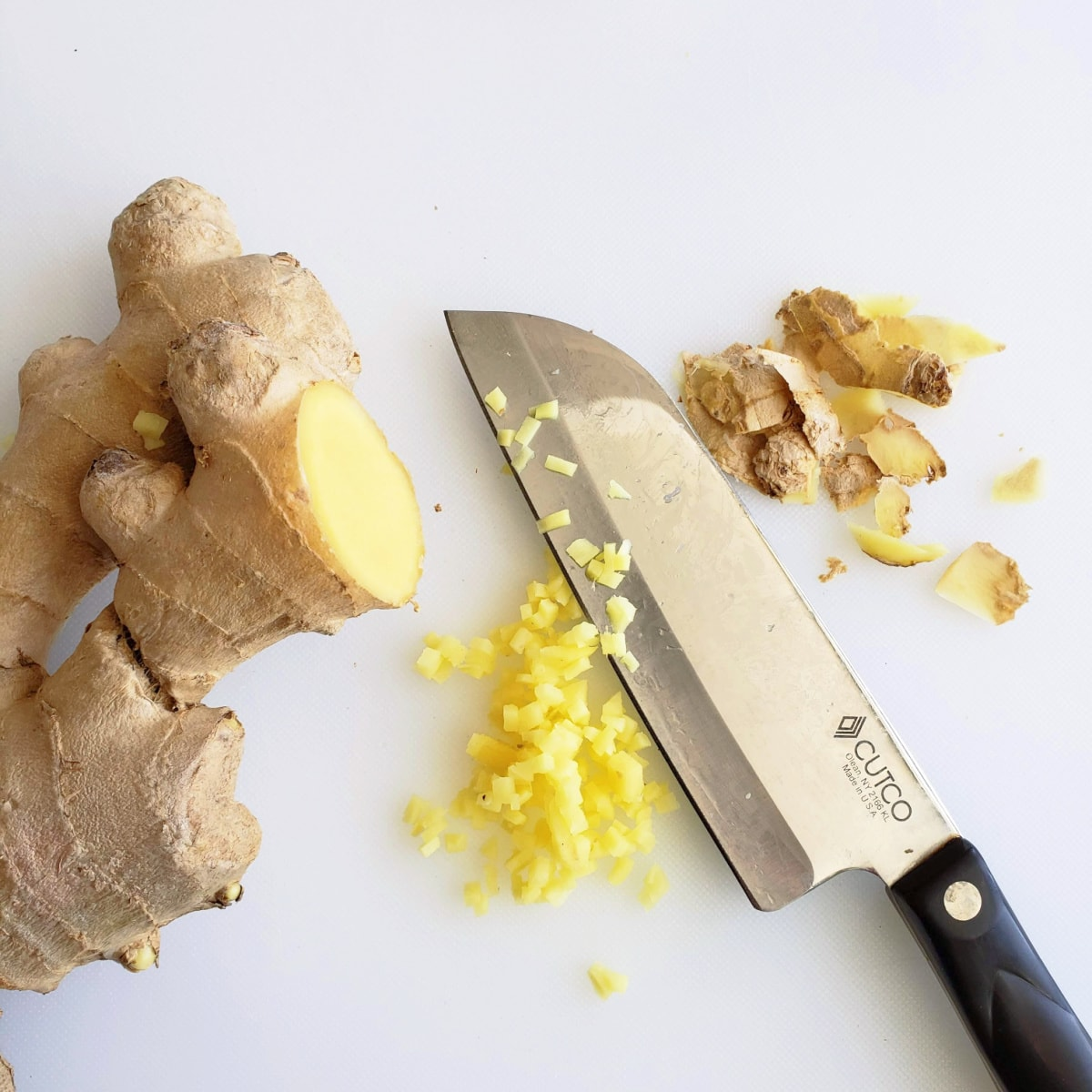 Peel the ginger skin off and finely mince it with a knife on a white cutting board