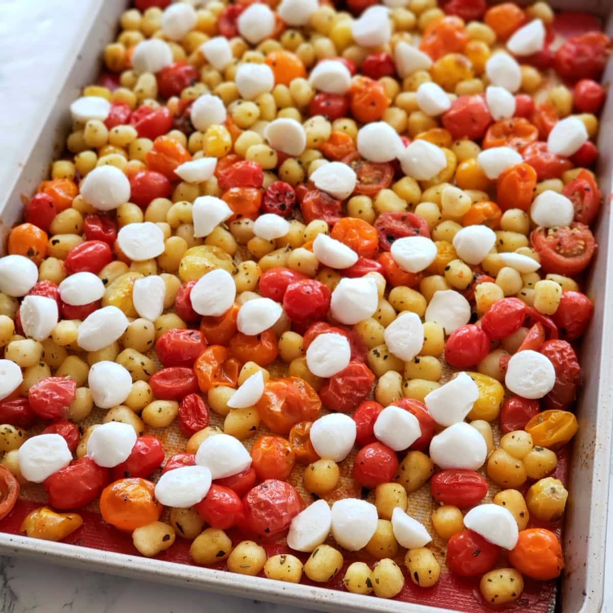Add the mozzarella balls to the hot tomatoes and gnocchi