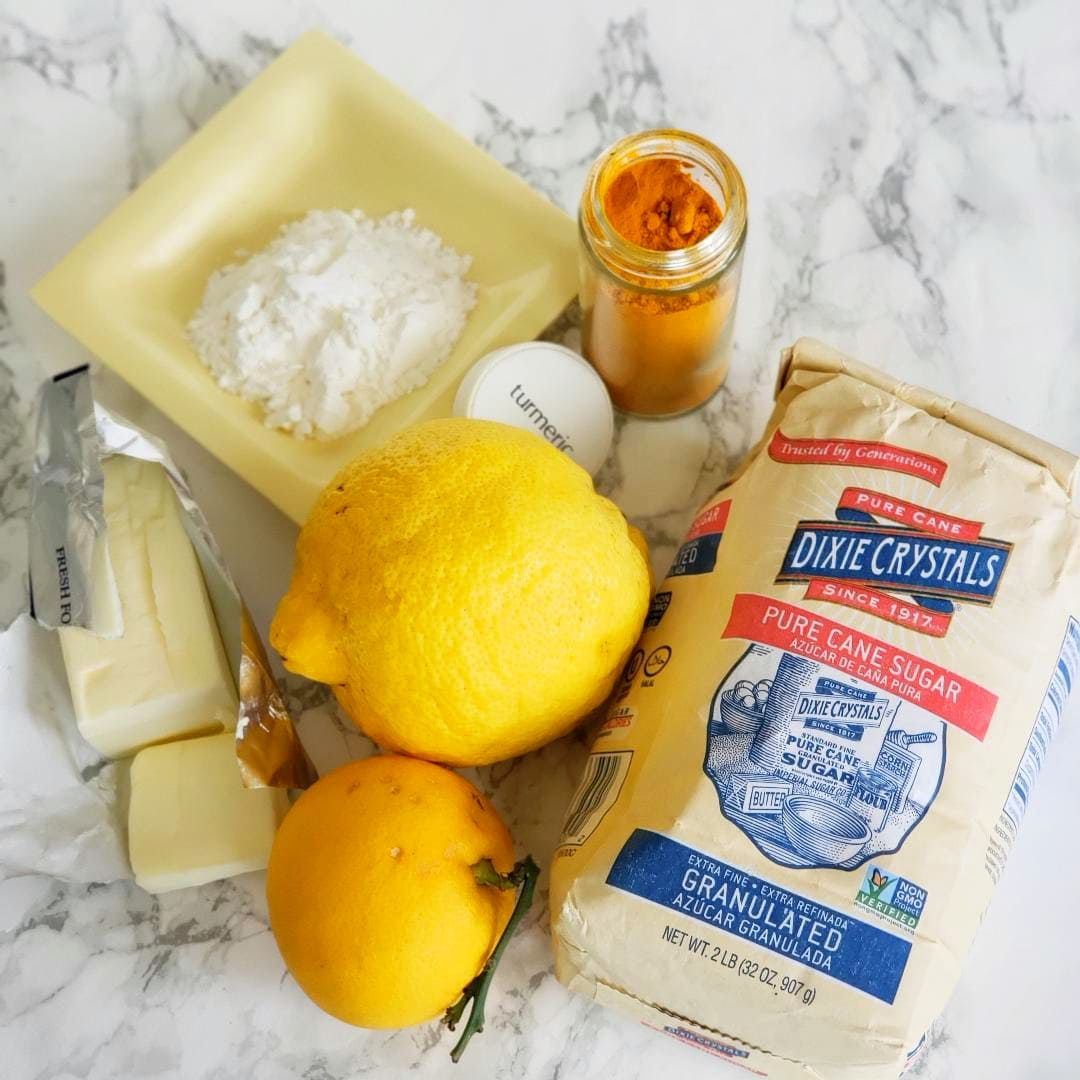 Ingredients for Lemon Filling Recipe on a white marble counter on ShockinglyDelicious.com