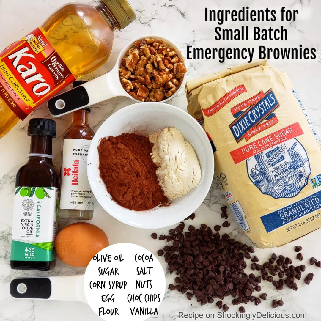 Ingredients for Small Batch Emergency Brownies laid out on a white marble counter