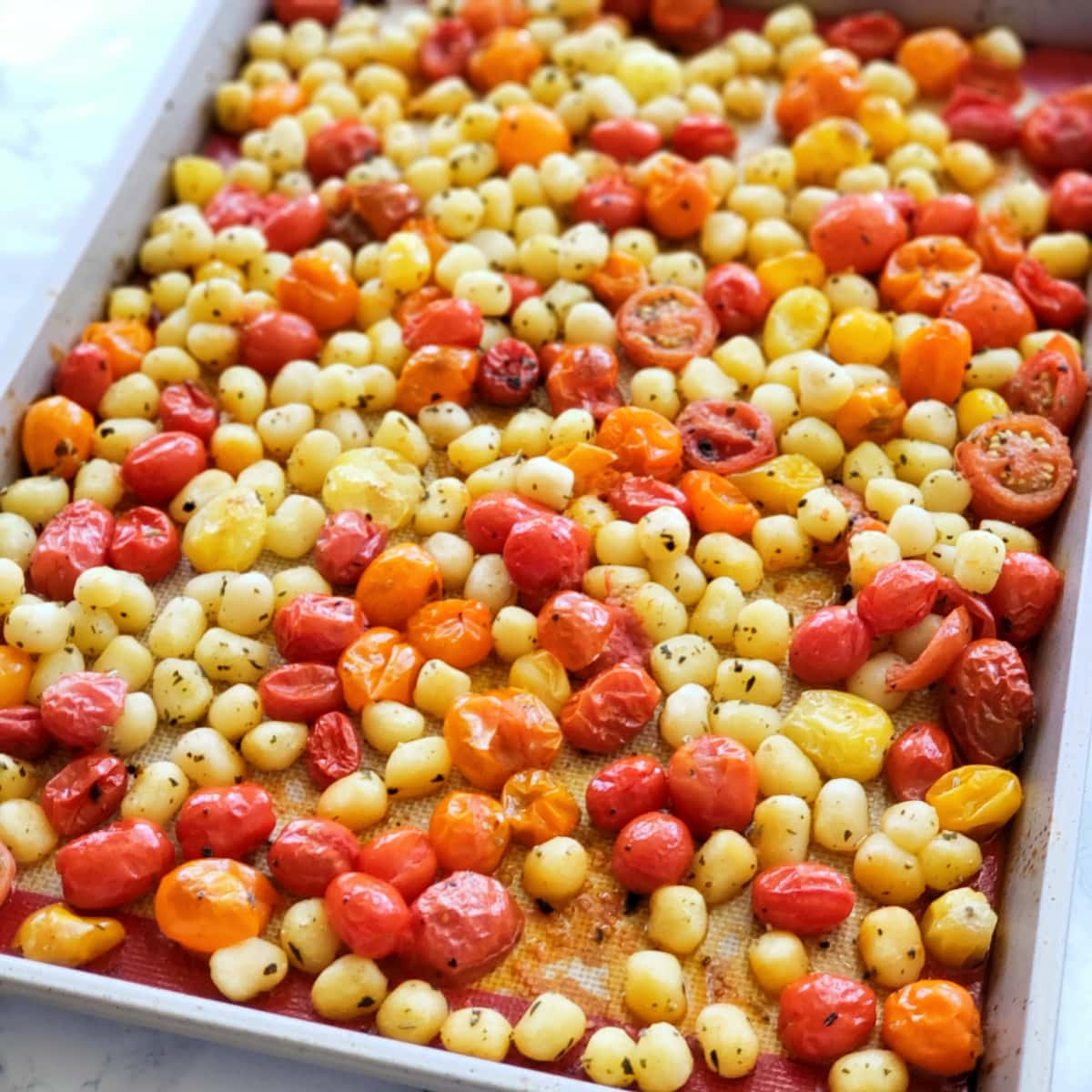 Tomatoes and gnocchi roasted straight from the oven
